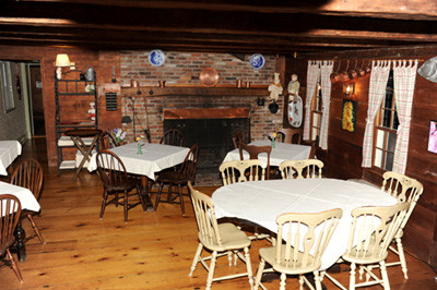 The dining room at Squire Tarbox Inn and Restaurant. The original building was built in 1763, and an addition was added inn 1820. The inn retains many of its original features, including wide boards and exposed timbers.
