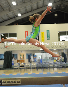 Elizabeth Rethman catches some air while performing a split leap on the beam.