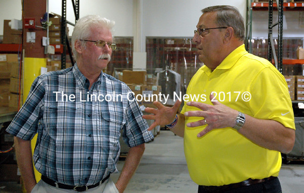 Maine Gov. Paul LePage (right) talks shop with R.H. Reny Inc. President John Reny at the Renys distribution center in Newcastle Wednesday, Aug. 20. 