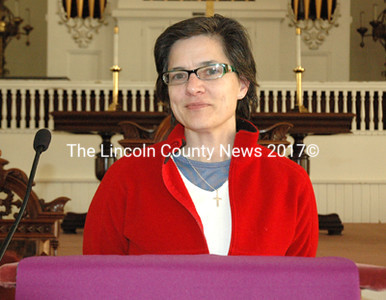 Marilee Harris, pastor of the Damariscotta Baptist Church, stands at the pulpit March 17. Church members selected Harris as the first female pastor in the church's 195-year history in a unanimous vote Feb. 23. (J.W. Oliver photo)