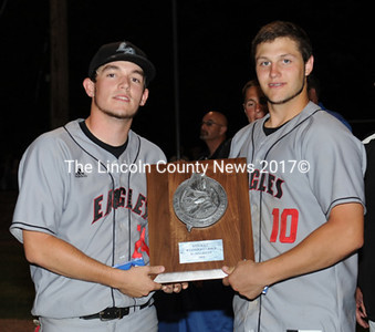 Lincoln Academy captains Sawyer Pinkham and A.J. Oliver hold the West Class B baseball runner-up plaque.