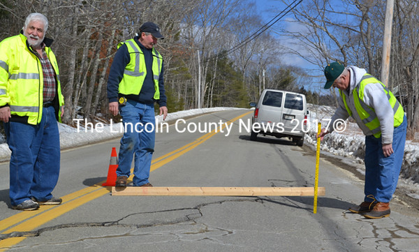 Bremen Project Manager Tom Kostenbader (right) measures a seven inch change in grade over a horizontal distance of roughly two feet on Route 32. (D. Lobkowicz photo)
