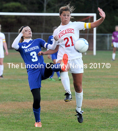 Miranda McIntire and Monica Ouleette battle for the ball in Madison's 2-0 win over Wiscasset Monday night. (Paula Roberts photo)