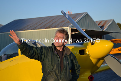 Nick Knobil, aka Hairball, stands with his plane, The Yellow Peril, outside his hangar at the Wiscasset Municipal Airport Saturday, Dec. 27. (Abigail Adams photo)