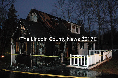 A house at 57 Lakeview Road in Boothbay Harbor lies in ruins after a fire Christmas night. (J.W. Oliver photo)