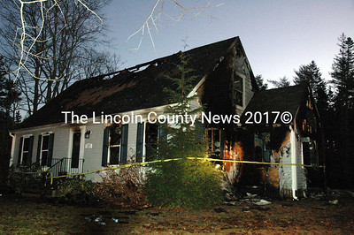 Caution tape surrounds a house at 57 Lakeview Road in Boothbay Harbor after a Christmas night fire. (J.W. Oliver photo)