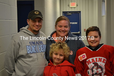 Ron Cyr Jr. stands with his wife, Tonya Cyr, and children Brody (center) and Caleb at the ice rink in Hallowell Sunday, Dec. 28. (Abigail Adams photo)