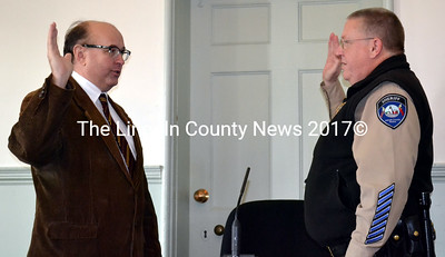 Maine Secretary of State Mathew Dunlap (left) administers the oath of office to re-elected Lincoln County Sheriff Todd Brackett at the Lincoln County Courthouse Friday, Jan. 2. (Charlotte Boynton photo)