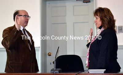 Maine Secretary of State Matthew Dunlap (left) administers the oath of office to re-elected County Registrar of Deeds Rebecca Wotton at the Lincoln County Courthouse Friday, Jan. 2. (Charlotte Boynton photo)