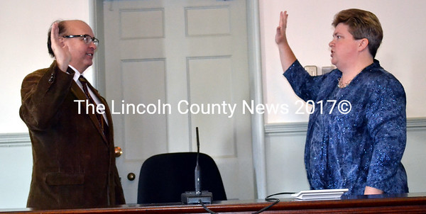 Maine Secretary of State Matthew Dunlap (left) administers the oath of office to newly elected Lincoln County Register of Probate Catherine Moore at the Lincoln County Courthouse Friday, Jan. 2.(Charlotte Boynton photo)