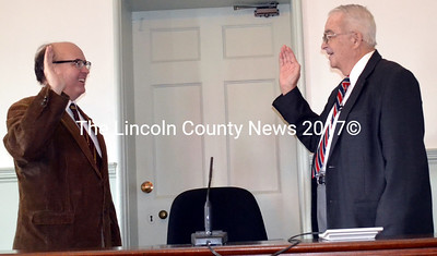 Maine Secretary of State Matthew Dunlap (left) administers the oath of office to re-elected Lincoln County Commissioner William Blodgett at the Lincoln County Courthouse Friday, Jan. 2. (Charlotte Boynton photo)