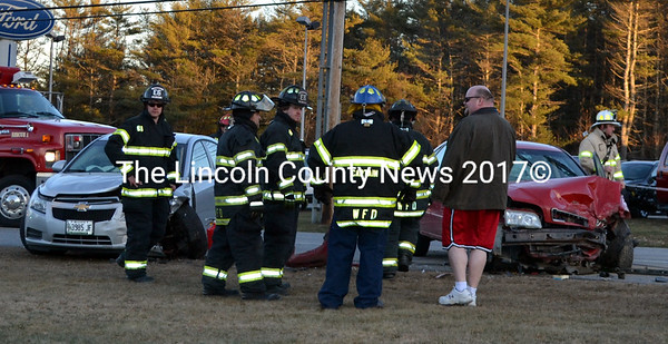 Wiscasset firefighters respond to the scene of a head-on accident on Route 1 in Wiscasset Dec. 31. The driver of the red Volvo at right had been cited for illegal inhalant use two hours before police say she crossed the centerline, causing the accident. (Michelle Switzer photo)