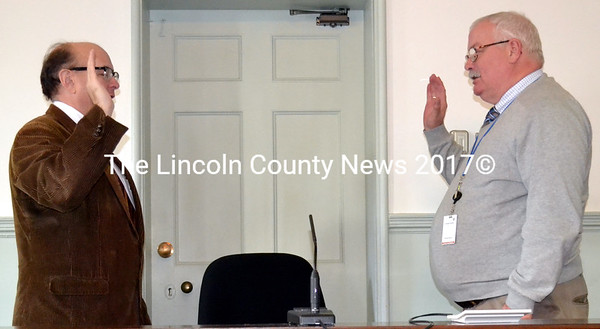 Maine Secretary of State Matthew Dunlap (left) administers the oath of office to Lincoln County Treasurer Richard Newell at the Lincoln County Courthouse Friday, Jan. 2. (Charlotte Boynton photo)