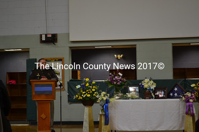"""Lincoln County Sheriff Todd Brackett shares his memories of Donald """"Donnie"""" Smith during Smith's memorial service at the Wiscasset Community Center Tuesday, Jan. 13.  Brackett and Smith worked closely together during Smith's time at the sheriff's office. (Abigail Adams photo)"""