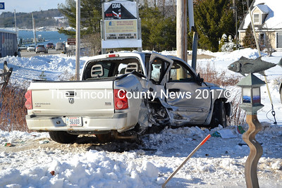 A Dodge Dakota rests in an embankment with significant damage - including a missing passenger side rear wheel - after a collision with a Pepsi truck off Route 1 in Edgecomb Wednesday, Jan. 7. The driver of the Dakota made a left-hand turn into the path of the larger truck. She was transported by ambulance to LincolnHealth - Miles Campus in Damariscotta. (Abigail Adams photo)