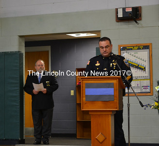 """Wiscasset Police Chief Troy Cline shares his memories of Donald """"Donnie"""" Smith at Smith's memorial service in Wiscasset, Jan. 13. """"He wasn't just a member of my team, he was my friend,"""" Cline said. Rev. Tom Wagers, who officiated the service, is pictured inthe background. (Abigail Adams photo)"""