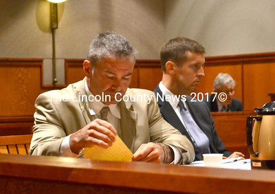 Pictured with his attorney Walter McKee (right), Philip Cohen, of Waldoboro, sits at a hearing in Cumberland County Superior Court Oct. 13, 2014. At the hearing, Cohen's deferred disposition on charges of disorderly conduct and violation of condition of release was terminated after Justice Roland Cole found there was a preponderance of the evidence Cohen committed domestic violence assault in July. (D. Lobkowicz photo, LCN file)