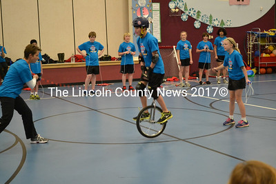 A member of the Spindrifters jumps rope on a unicycle during their performance at Edgecomb's Eddy School Jan. 15. (Abigail Adams photo)