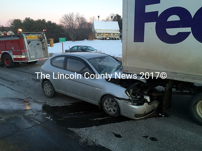 A 2008 Hyundai Accent shows heavy damage after rear-ending a FedEx box truck on Route 1 in Edgecomb Friday, Jan. 16. The driver of the car suffered minor injuries in the accident. (J.W. Oliver photo)