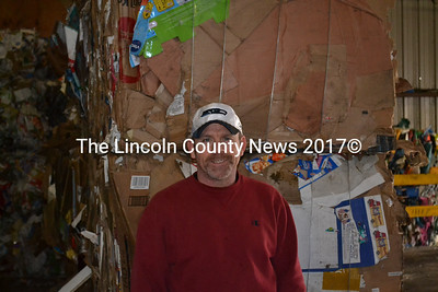 Lincoln County Recycling Program Supervisor Tim Richardson stands in front of baled mixed paper at the recycling center in Wiscasset on Jan. 16. (Abigail Adams photo)