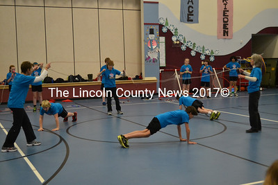 Members of the Spindrifters do pushups while jumproping at Edgecomb's Eddy School Jan. 15. (Abigail Adams photo)