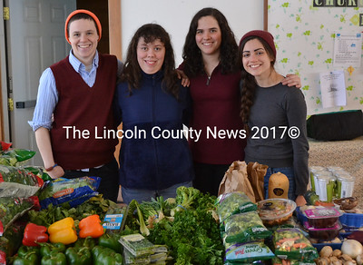 From Left: Chewonki Semester School teacher Lilly Betke-Brunswick, community volunteer Barbarak Welborn, and semester school students Carolina Hutt-Sierra and Callie Sofis-Scheft volunteer at the Help Yourself Shelf Food Pantry at St. Philip's Church in Wiscasset on Thursday, March 5. (Abigail Adams photo)