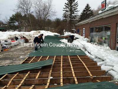 A construction crew works to dismantle an awning at the Louis Doe Home Center in Newcastle the morning of Thursday, March 5. The awning fell Wednesday evening, March 4. (J.W. Oliver photo)