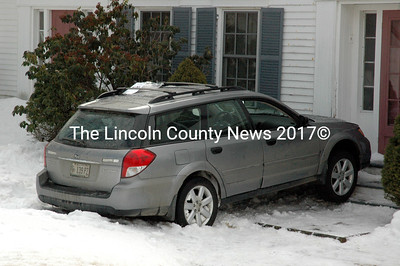 A Subaru Outback at rest against the door of a house on Ocean Point Road in East Boothbay Tuesday, March 10. The station wagon's driver experienced a medical issue and the car went airborne before landing in the front yard of the house. (J.W. Oliver photo)