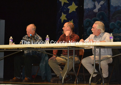 South Bristol Selectmen Chester Rice (left), Chris Plummer(center), and Ken Lincoln, sit on the stage during the town's annual town meeting.  (Michelle Switzer photo)