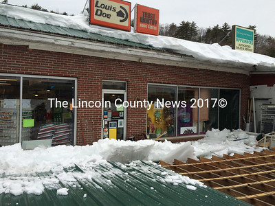 The ice and snow between the front door and the awning apparently slid off the roof of the main building and onto the overhang, causing it to collapse. (J.W. Oliver photo)