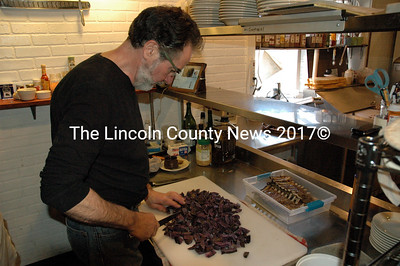 """Van Lloyd's Bistro co-owner Bernie DeLisle preps black diamond frites for the Damariscotta restaurant's grand reopening Tuesday, March 31. Down East magazine recently named Van Lloyd's one of """"Maine's Best New Restaurants."""" (J.W. Oliver photo)"""