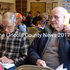 Bremen residents Steve Laurich (left) and Nelson Webber raise their cards to vote during annual town meeting March 28. (D. Lobkowicz photo)