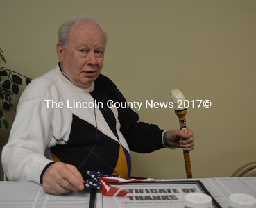 James Craig sits with his personalized eagle cane after a luncheon at Hodgdon Green March 27. (Michelle Switzer photo)