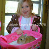 Anna Brackett, 4 from New Harbor, was delighted by the bunnies on Easter Sunday. (Eleanor Cade Busby photo)