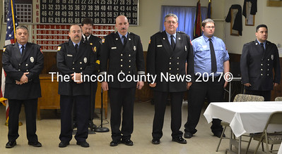 Neil Kimball (back), president of the Lincoln County Fire Chiefs Association, installs the 2015 officers of the Waldoboro Firemen's Association: (from left) Bill Bragg, president; Brian Perry, vice president; John Blodgett, treasurer; Kyle Santheson, delegate to the Maine Federation of Fire Fighters; Gabe Cooley, delegate to the Knox County Firefighters Association; and Luis Ruano, secretary. (D. Lobkowicz photo)