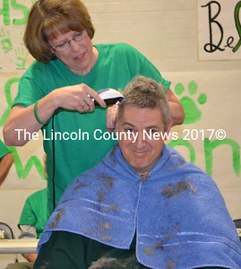 Science teacher Chris Lynch gets his head shaved in support of Medomak Valley High School Principal Harold Wilson's recent cancer diagnosis. (Michelle Switzer photo)