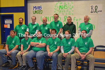 A dozen Medomak Valley High School teachers lent their locks to the cause, agreeing to have their heads shaved in a fundraising effort for MVHS Principal Harold Wilson. Shown from left to right back: Rich Warner, Andrew Cavanaugh, Steve Ocean, Kevin Richardson, Chris Lynch, and Neil Lash. Front left: Randy Hooper, Scott Hastings, Jake Newcomb, Ryan McNelly, Steve Gleason, and Matt Lash.  (Michelle Switzer photo)