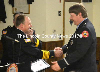 Fire Chief Paul Smeltzer presents the Chief's Award to Lt. Roy Hatch. (D. Lobkowicz photo)