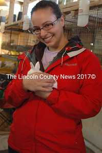 Diana Sanders has a cuddle with a baby bunny courtesy of Barber's Bunnys. (Eleanor Cade Busby photo)