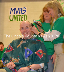 Assistant Principal Andrew Cavanaugh grins as the last of his hair is shorn away. (Michelle Switzer photo)