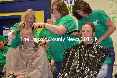 MVHS staff members Scott Hastings and Steve Gleason go under the clippers. (Michelle Switzer photo)