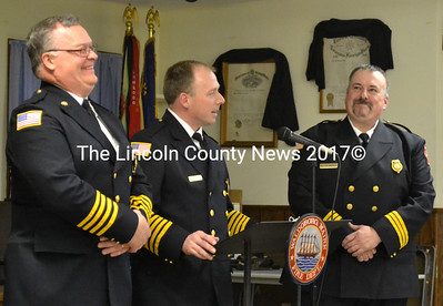 Deputy Chief Dale Smith (left) and Assistant Chief Bill Maxwell chuckle as Waldoboro Fire Chief Paul Smeltzer gives a speech at the department's annual recognition banquet April 4. (D. Lobkowicz photo)