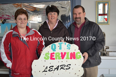 A new sign for QT's Ice Cream Parlor, at 47 Railroad Ave. in Wiscasset, notes Lears' ice cream will soon be served. The sign will be posted with the grand opening Sunday, April 12, at 11 a.m. Shown left to right, QT's owner Tammy Brooks, with Pam and Ron Lear, former owners of the Lear's Ice Cream shop. (Charlotte Boynton photo)