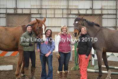Stonewall Stables staff with two of their many horses. The farm will host a spring fling April 18, from 2-4 p.m. From left: Erin Judkins, Jess Taylor, Crissy Bradley, and Virginia Shaw. The horses are Pablo (left) and Cocoa. (Michelle Switzer photo)