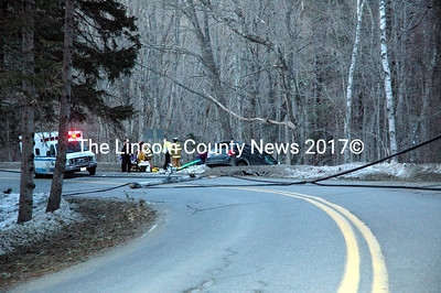 Emergency personnel respond to a single-vehicle accident on Waldoboro Road in Bremen April 1. The Lincoln County Sheriff's Office suspect alcohol was a factor in the accident. (J.W. Oliver photo)
