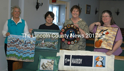 Ruth Vietze, Marilyn Ingham, Meredith Fossett, and Cindy DeLong. (left to right) show their Puffin themed quilt pieces. The Clamshell Quilters will enter these in the Maine State Quilt Show in Augusta July 24- 26. (Eleanor Cade Busby photo)