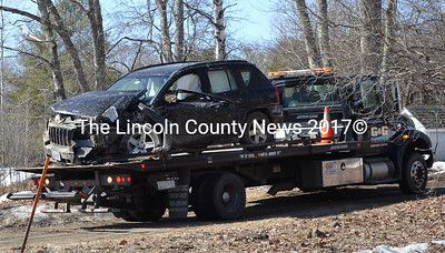 The car involved in the fatal motor vehicle accident on Route 27 in Boothbay is towed from the scene at approximately 10:30 a.m. on Wednesday, April 8. The car was traveling south on Route 27 when it drove off the road and hit a utility pole and a tree. (Abigail Adams photo)