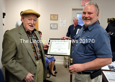 Eugene Walsh accepts the Boston Post Cane and a certificate from Newcastle Board of Selectmen Chairman Brian Foote Monday, April 13. (J.W. Oliver photo)