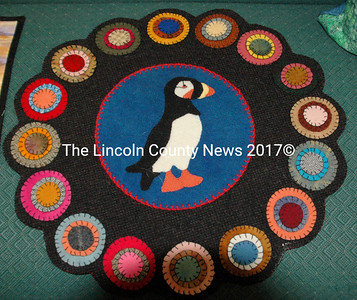 "Meredith Fossett's piece is a form of ""Penny Rug"" made of quilted felt. (Eleanor Cade Busby photo)"