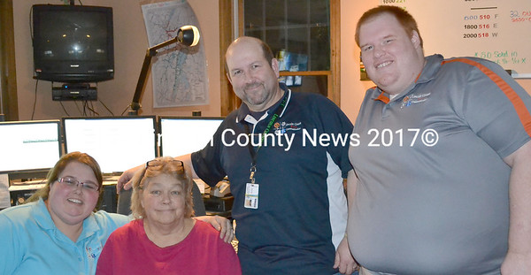 Dispatchers Emily Snowman, Pamela Reed, supervisor Mark Creamer, and Craig Balsdon (left to right) work the night shift at the Lincoln County Communications Center Saturday, April 10. (Abigail Adams photo)